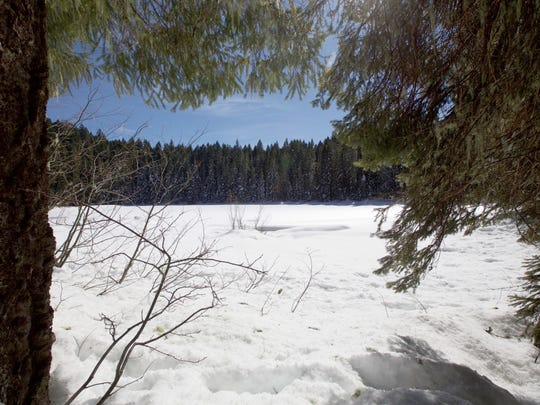 Fey Lake, covered by snow, can be reached via snowshoe during winter.