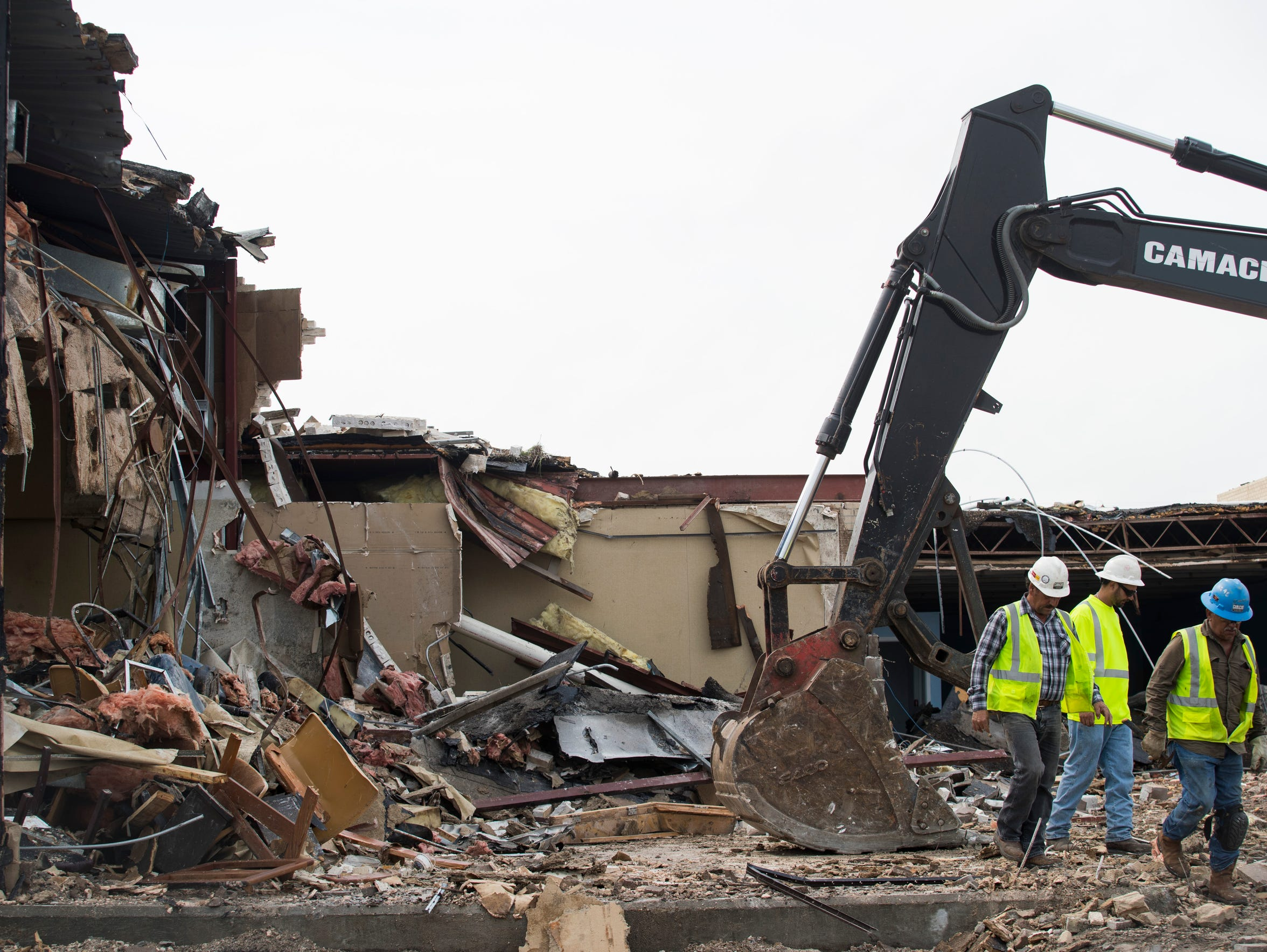 Contractors work to demolish the Aransas County Courthouse