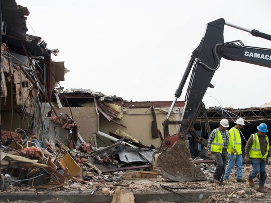 Contractors work to demolish the Aransas County Courthouse on Thursday Feb.22, 2018 in Rockport. The building was severely damaged from Hurricane Harvey.