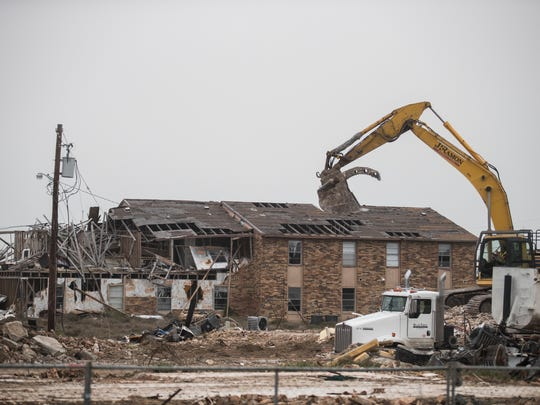 Contractors work to demolish an apartment complez on Tuesday Feb. 20, 2018 in Rockport. The building was severely damaged from Hurricane Harvey.