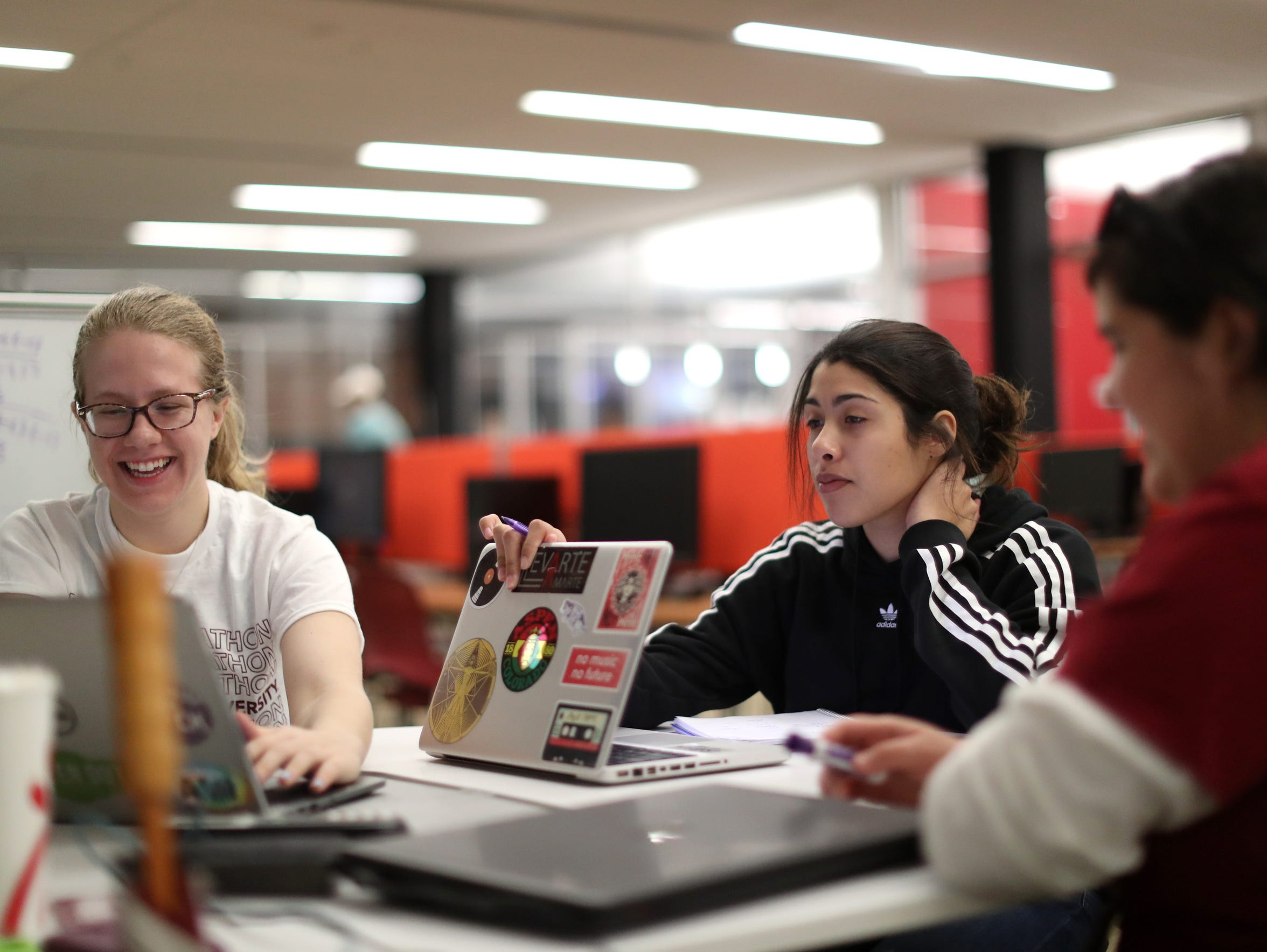 FSU Junior Brittny Nail, right, helps to tutor Grace