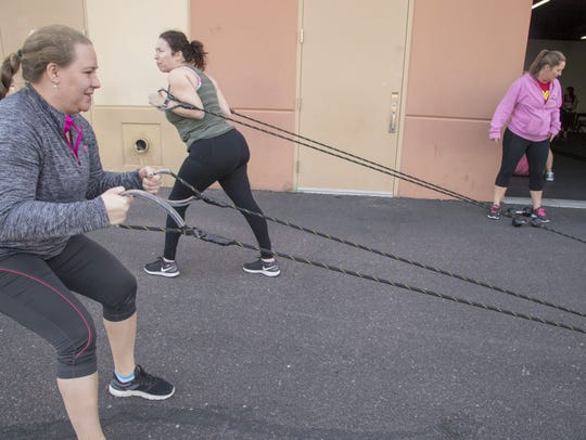 Cydney Dell, in front, works out at Iron Girlz, a fitness