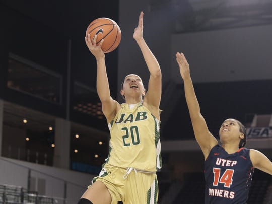 UAB's Deanna Kuzmanic goes up for a layup as UTEP's Najala Howell tries to defender her. UAB eliminated UTEP from the Conference USA tournament.