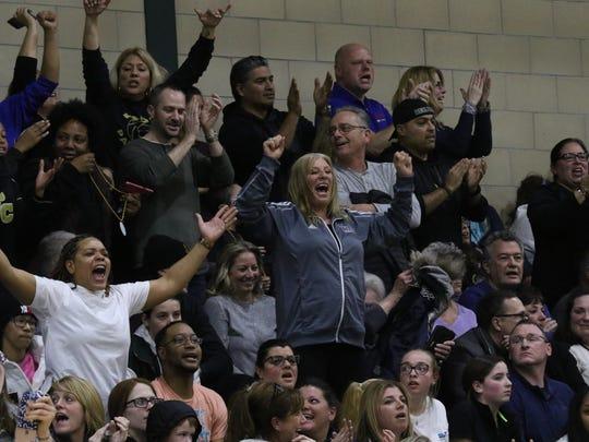 IHA fans cheer on their team.