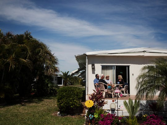 Oak Park Mobile Village in Alva part time residents, Don and Carol Perone along with John and Donna Ricardo enjoy the weather on what used to be their lanai. The lanai was ripped off in Hurricane Irma six months ago. They are waiting to get it repaired.
