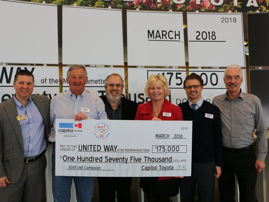 From left, Alex Casebeer, Scott Casebeer, Ron Hays, Carrie Casebeer, Matthew Casebeer and Mike Long during a presentation of $175,000 to United Way on Thursday, March 8, 2018.