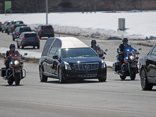 Fellow officers guide the hearse carrying the body of Wilmington Police Capt. Stephen Misetic the procession drives along Rt. 202 to a private burial in Pennsylvania on Friday afternoon.