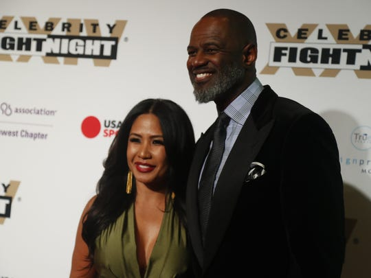 Brian McKnight and Leilani Malia Mendoza pose for pictures during the red carpet at Celebrity Fight Night inside JW Marriott Desert Ridge Resort and Spa on March 10, 2018, in Phoenix, Ariz.
