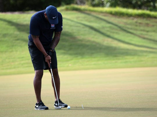 Former Green Bay Packers cornerback Seneca McMillan putts during the Earl Morrall Celebrity Golf Tournament at The Strand in Naples on Monday. All proceeds from the tournament go to the United Way of SWFL, Drug Free Collier and Caring for Kids of the NFL Alumni.