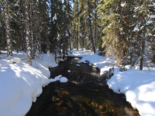A view of the snow-covered North Santiam River is a