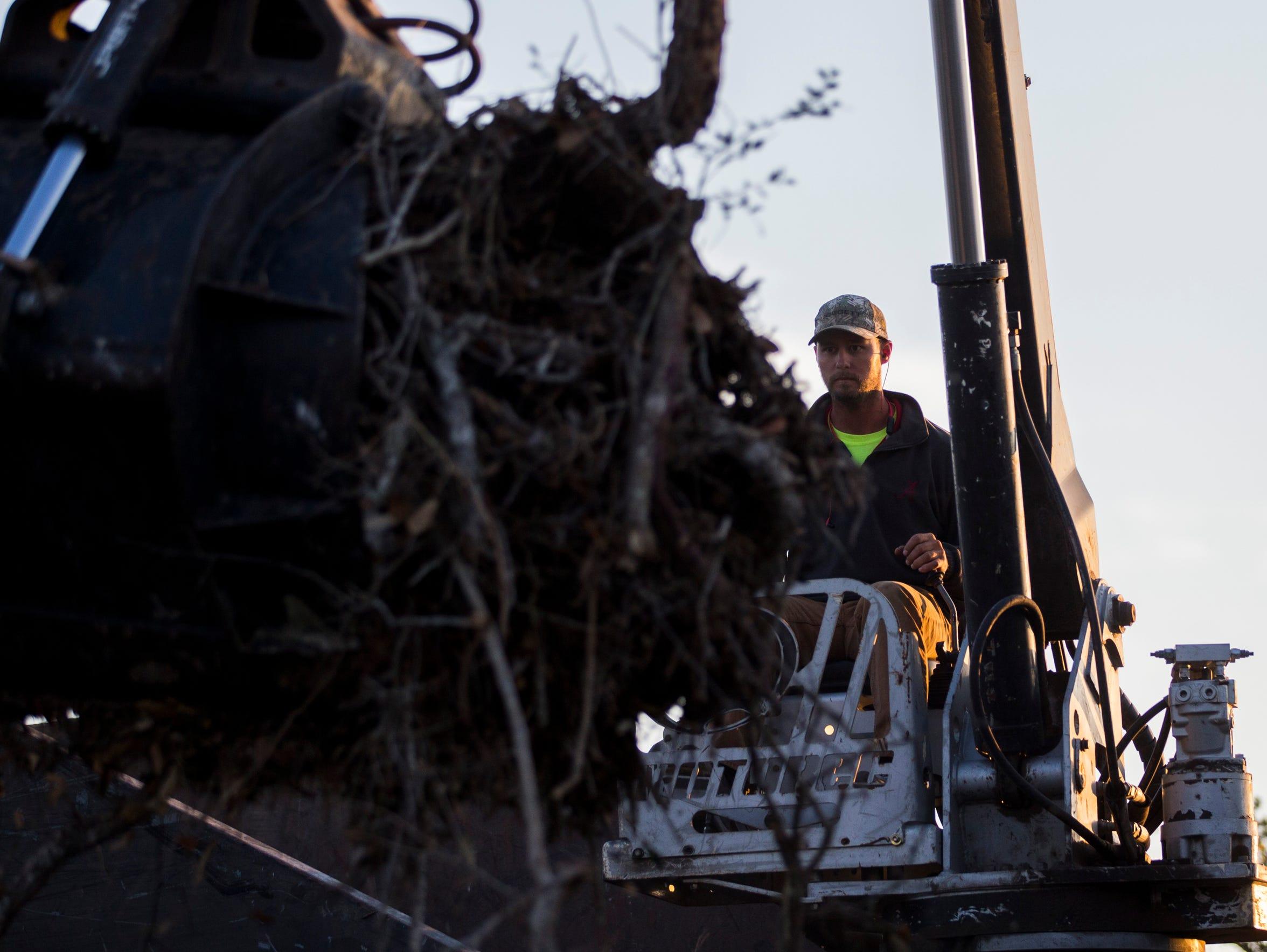 Crowder Gulf contractor Drew Prichard loads up his