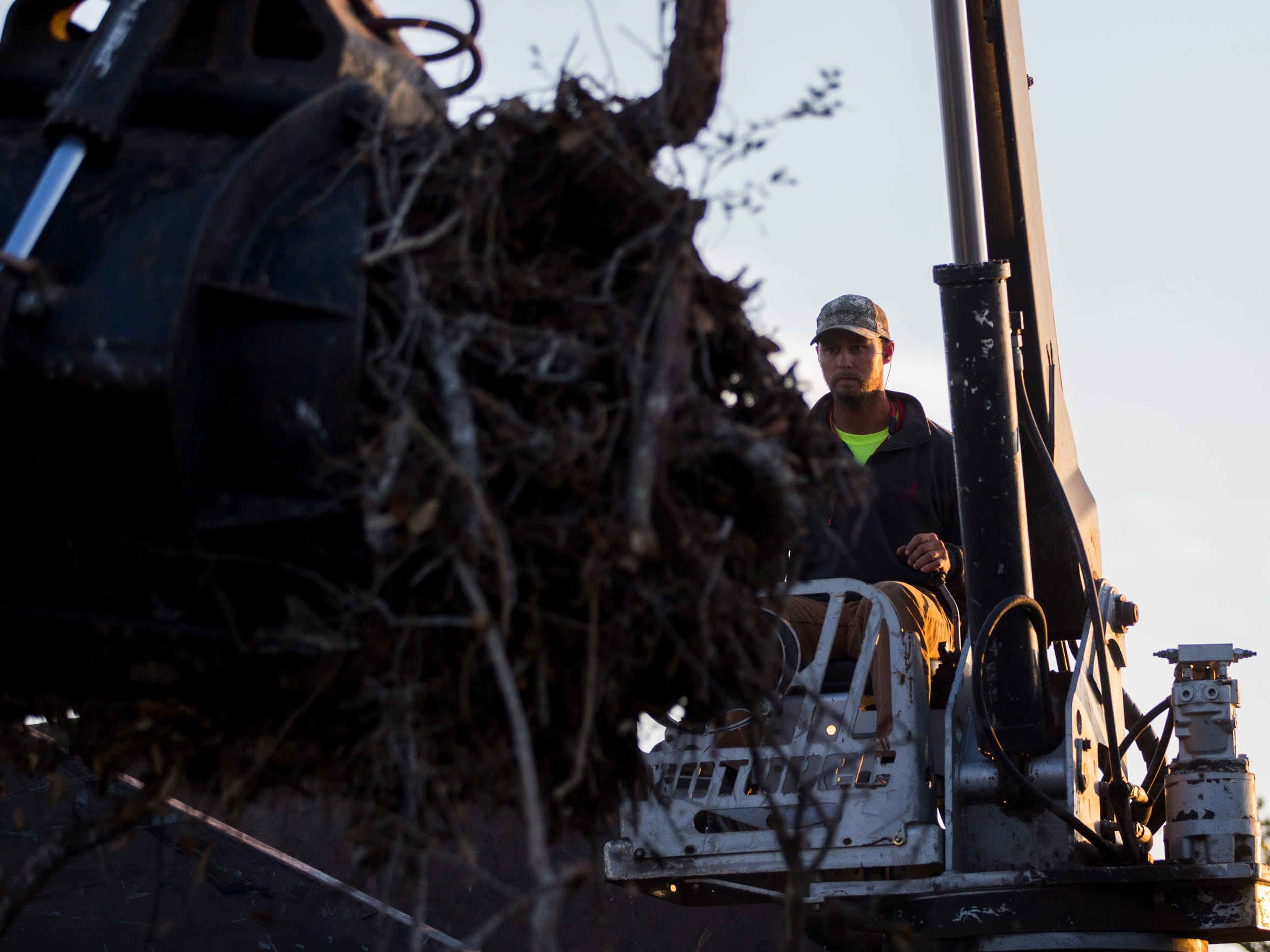 Crowder Gulf contractor Drew Prichard loads up his truck with debris on Wednesday, March. 14, 2018 in Aransas County.