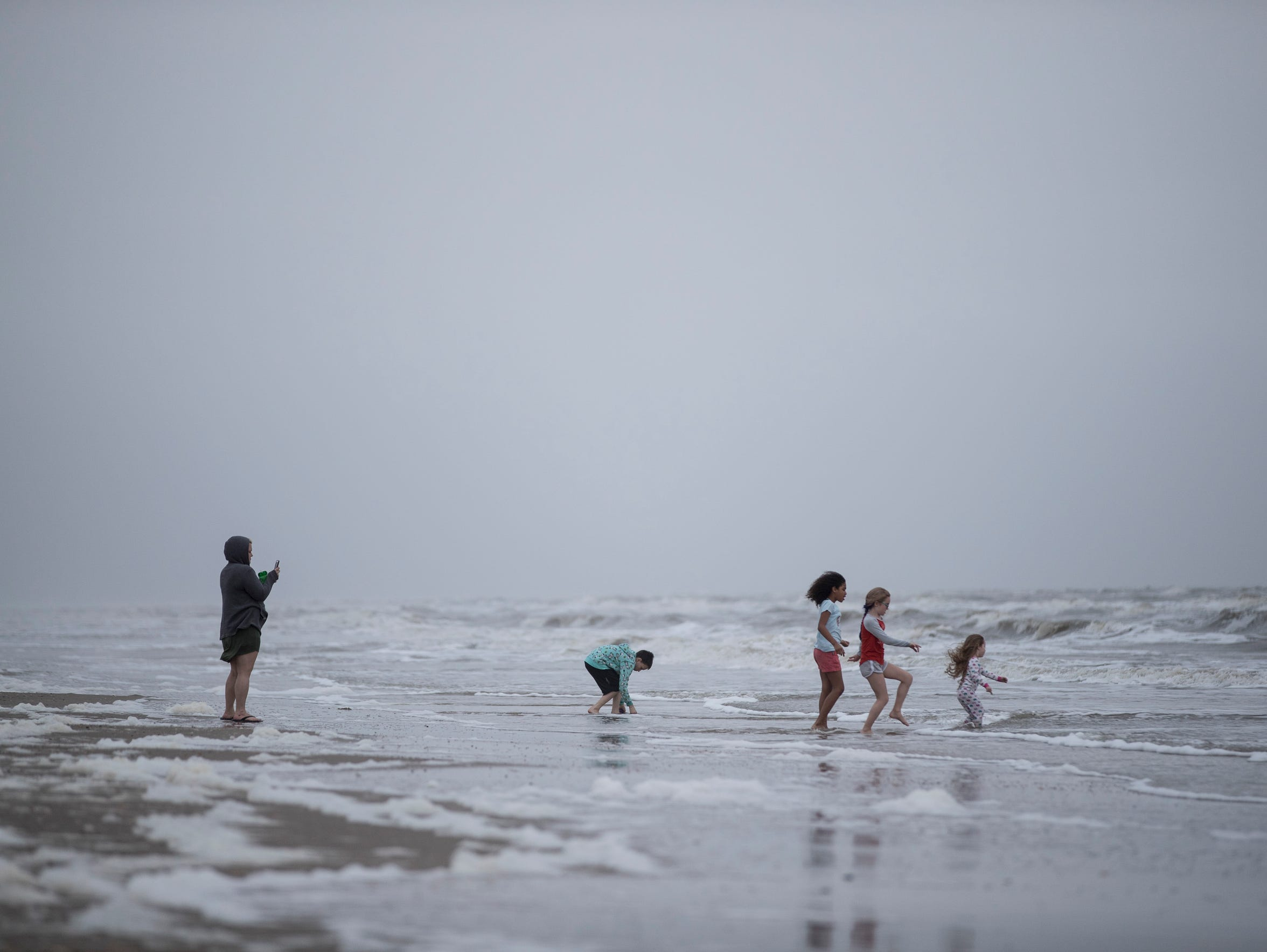 Families play in the water at crystal beach on Saturday,