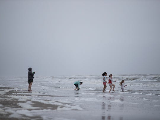 Families play in the water at crystal beach on Saturday, March. 10, 2018 on Bolivar Peninsula.