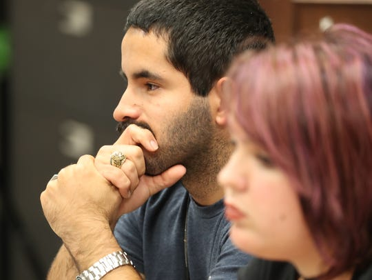 Jesus Rodriguez, Ida Baker, listens to other students
