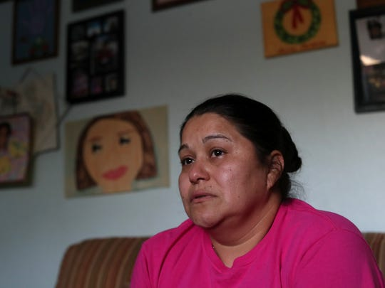 """Gladis de la Cruz at her Quincy home on Thursday, Feb. 15, 2018. Cruz is Salvadoran and has lived in the U.S. on temporary protected status for more than ten years, a status that is set to be discontinued by the current administration 2019. """"I feel like it is a bad dream. When you feel like (TPS) is going to end,"""" Cruz said. """"All these things in [El Salvador]… our family has already been affected. They killed my dad— people that don't have a heart, just for a couple dollars—you don't have it, you lose."""""""