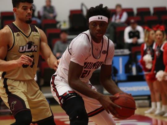 Austin Peay's Terry Taylor looks to make a move in