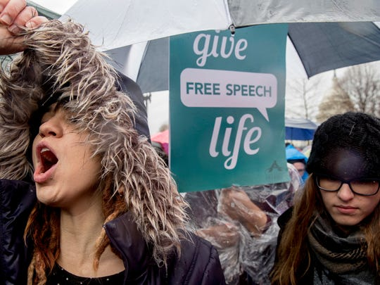 Anti-abortion demonstrators cheer during a rally outside the Supreme Court in Washington, on Tuesday as the Supreme Court hears arguments in a free-speech fight over California's attempt to regulate anti-abortion crisis pregnancy centers.
