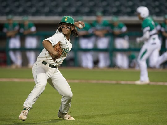 Bishop's Nic Hernandez throws a the ball to third base