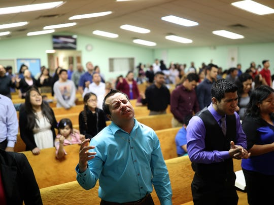 Parishioners pray at the Casa de Adoracion Emanuel church in Quincy on Sunday, March 11, 2018. The two-hour Spanish language service is home to a mostly Central American immigrant population.
