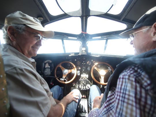 """Colin Soucy, left, and Tom Weller pilot the first-ever mass produced airliner, the Ford Tri-Motor 5-AT, which flew its first flight on December 1, 1928, which has landed in Tallahassee. The Experimental Aircraft Association is offering rides to the public on the passenger plane, known as the """"Tin Goose"""", throughout the weekend."""