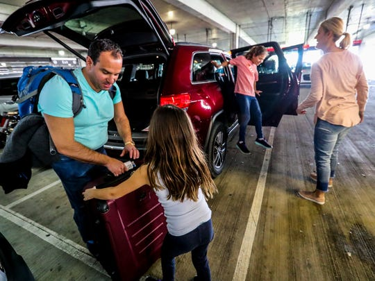 Charlie Margosian, from Naperville, IL, gets help from his daughter, Katie, 6,  to load up the bags into the rental car before heading to their condo. The Margosian family is down on spring break. The car rental building at RSW opposite the terminal is a hopping spot this time of year as spring break puts a big demand on rental cars. RSW is known as a car rental hot spot, but during season cars are especially in demand.
