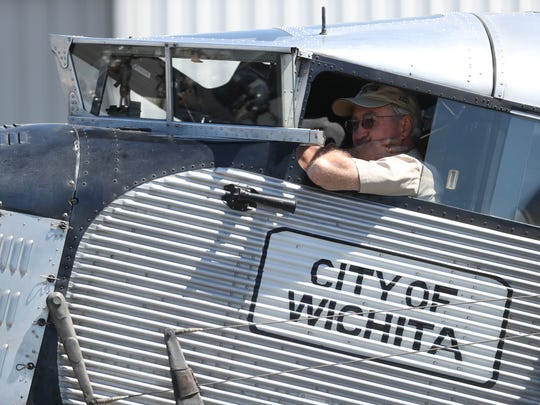 Colin Soucy looks out of the window as he pilots the first-ever mass produced airliner, the Ford Tri-Motor 5-AT, which flew its first flight on December 1, 1928, which has landed in Tallahassee.