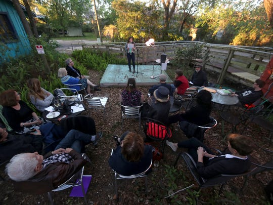 """Dorsey Elizabeth Olbrich reads some of her work at """"A World With Guns: Poems of Protest and Memorial"""" a reading at Black Dog Cafe in Railroad Square on Thursday, 22, 2018."""