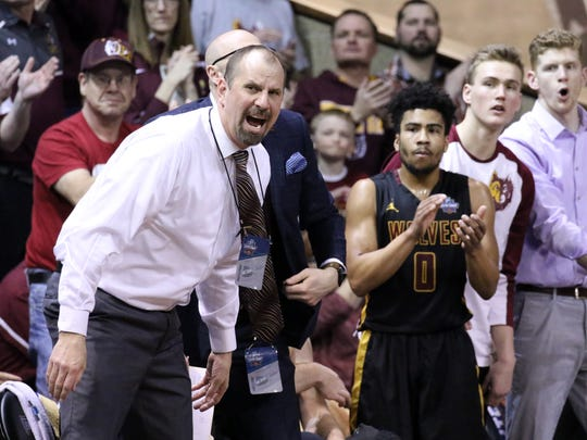 Northern State Head Coach Paul Sather yells instructions