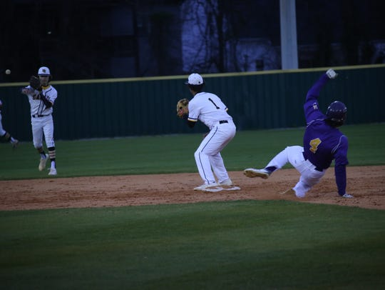 Clarksville High's Ford Cooper (4) slides into second