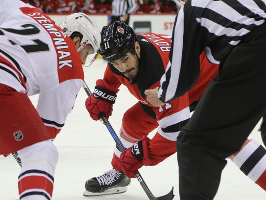 Lee Stempnial of Carolina and Brian Boyle of the Devils