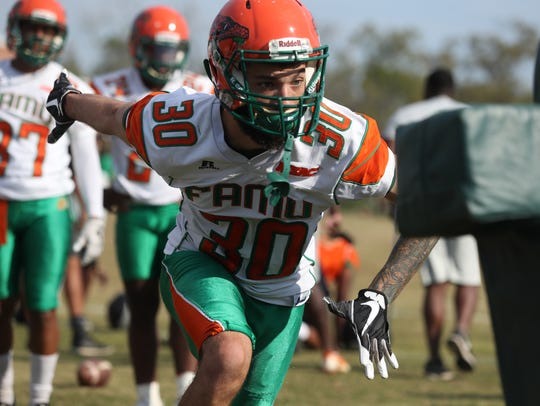 FAMU's Troy Hilton runs through a drill during the