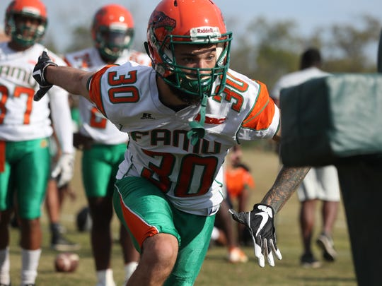 FAMU's Troy Hilton runs through a drill during the second day of their spring practice at the university on Friday, March 23, 2018.