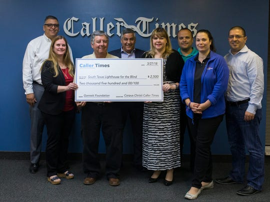 The South Texas Lighthouse for the Blind was awarded a $2,500 grant by the Gannett Foundation and the Caller-Times. Pictured holding the check are Jay Sanchez and Alana Manrow with the organization along with several Caller-Times leaders.