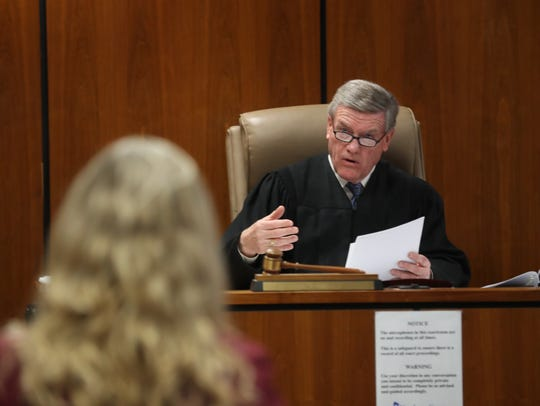 Judge James M. Blaney asks question of prosecutor