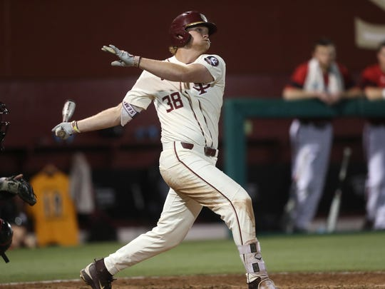 FSU's Rhett Aplin makes contact with a pitch against Louisville to help the Seminoles win 8-7 at Dick Howser Stadium on Friday.