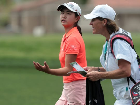 Rose Zhang and caddie Caryn Willson on 9 during the