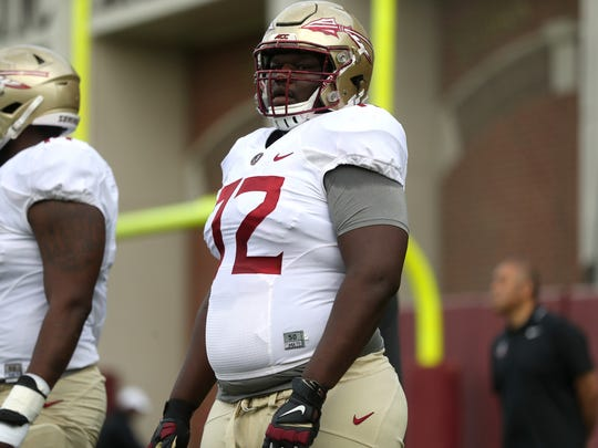 FSU's Mike Arnold works with his lineman teammates during football practice at the Al Dunlap Training Facility on Saturday, March 31, 2018.