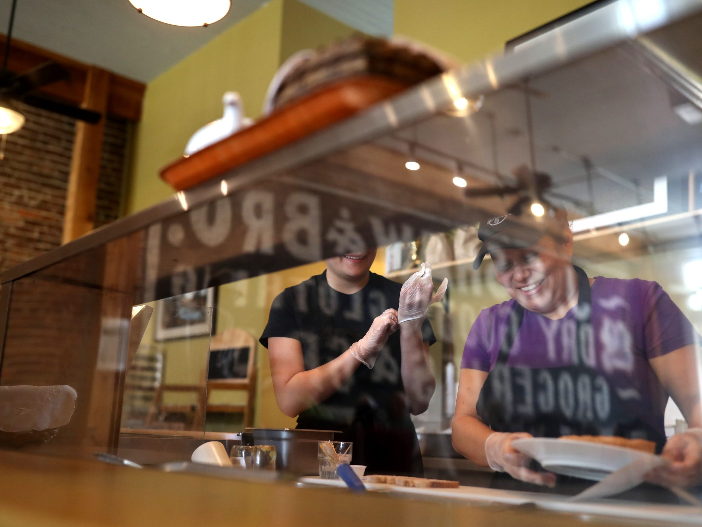 Gladis de la Cruz works at Damfino's Cafe & Market