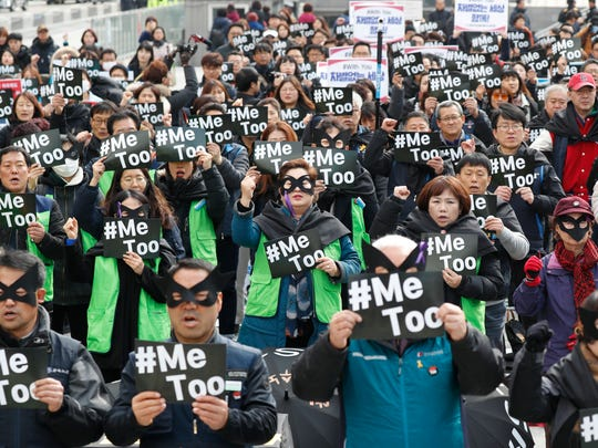 Participants show their support for the Me Too movement