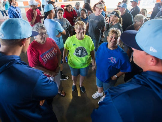 Zella Ickes, 85 (from left), Sheryl Brookes, 64, and Jennifer Brookes, 48, talk with Hooks players during the media day on Monday, April 2, 2018 at Whataburger field.