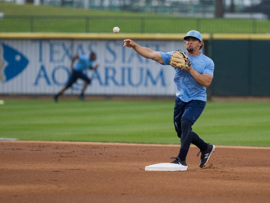 Hooks' infielder Ryne Birk throws to first during the