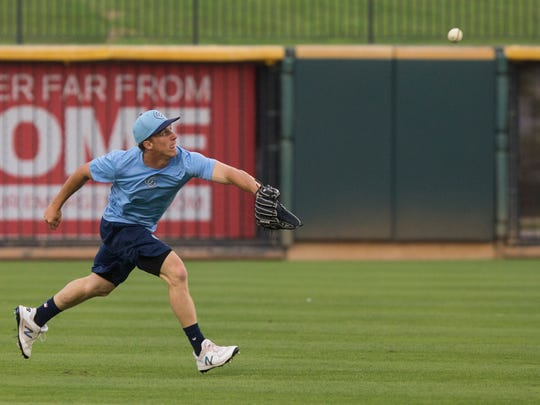 Hooks' outfielder Myles Straw catches balls during