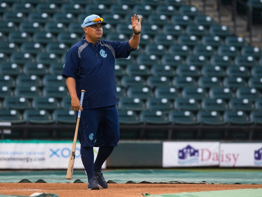 Hooks' manager Omar Lopez hits infielders ground balls during the Hooks media day on Monday, April 2, 2018 at Whataburger field.