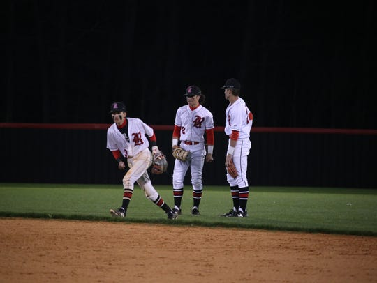 Rossview center fielder, Christian Scott (center),