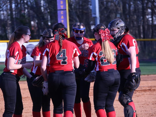 Rossview High's softball team meets at the pitcher's