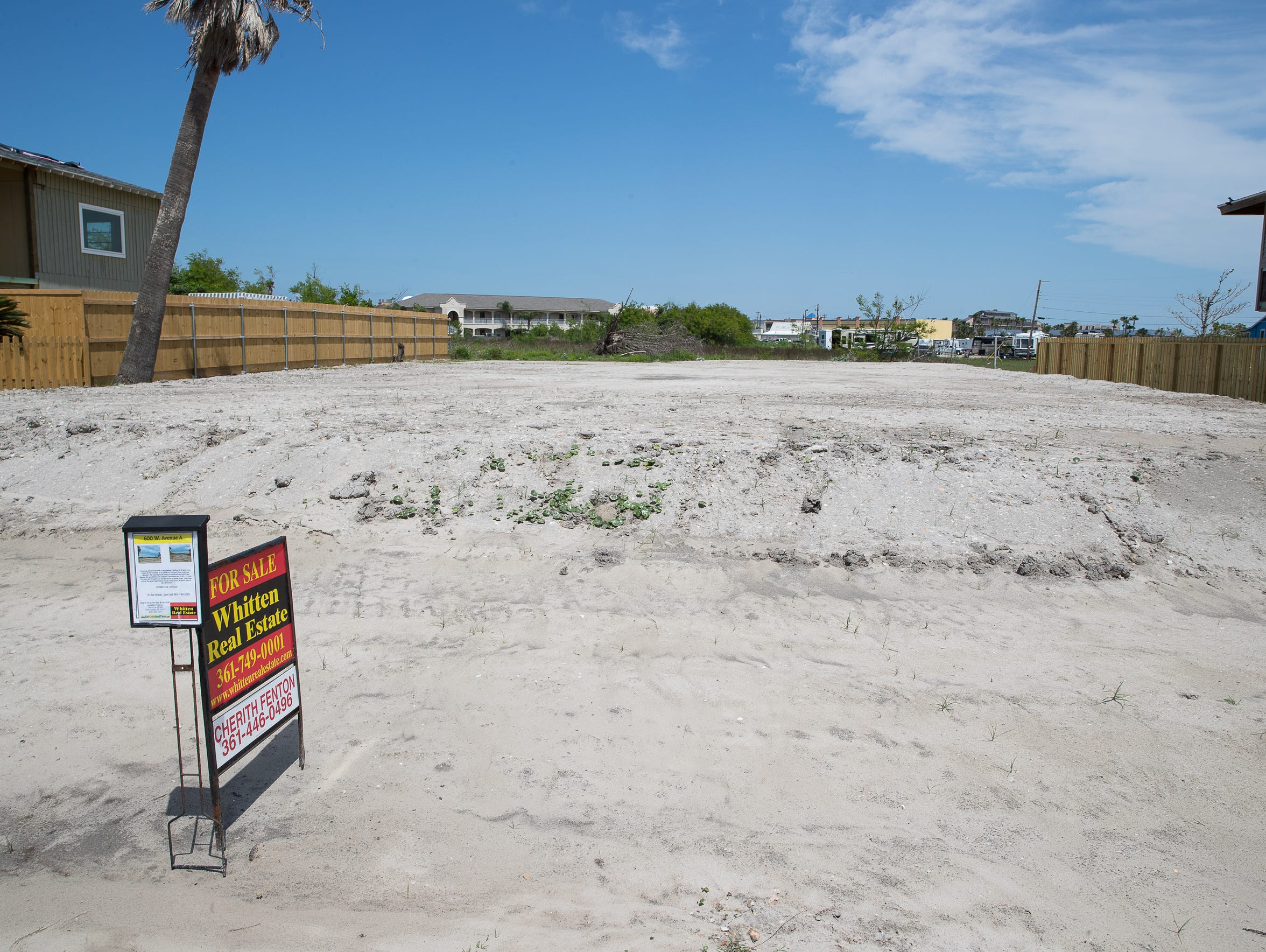 "A ""for sale"" sign is posted on the edge of an empty lot in Port Aransas in March. It's not known at this point how many homeowners will demolish their homes, how many will rebuild and how many will sell."