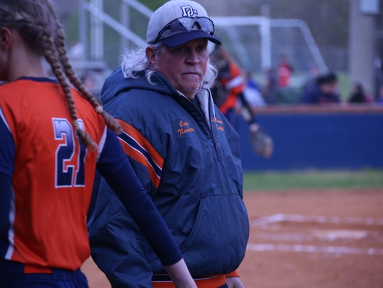 Dickson County softball head coach Bert Newberry encourages