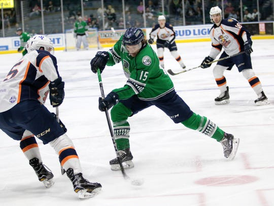 Florida Everblades forward Mitchell Heard shoots during the Everblades' final regular season home series against the Greenville Swamp Rabbits at Germain Arena on Friday, March 30, 2018. The Blades defeated the Swamp Rabbits, 5-3, and move to 48-13,-2-4 on the season.