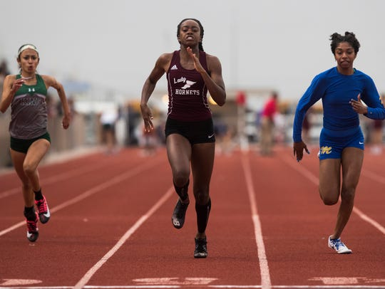 Runners Compete in the District 30-5A track meet at